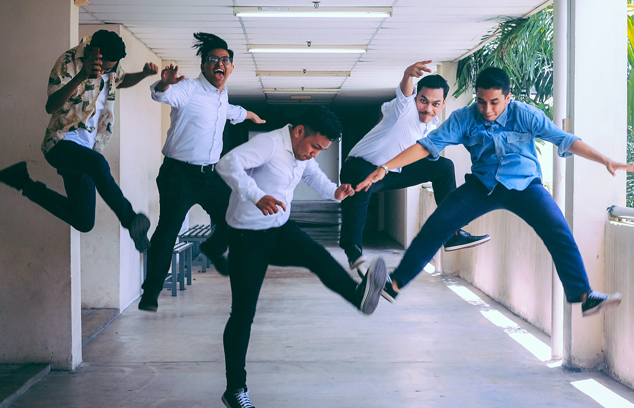 happy employees jumping at culture statement