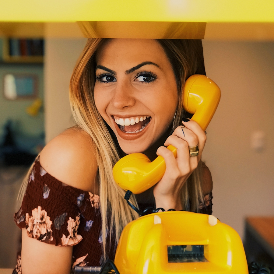 Happy woman calling references to apply for a position